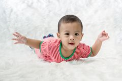 Smile baby boy is shooting in the studio. fashion image of baby and family. royalty free stock photos