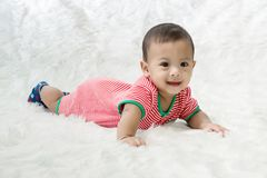 Smile baby boy is shooting in the studio. fashion image of baby and family. stock image