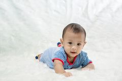 Smile baby boy is shooting in the studio. fashion image of baby and family. royalty free stock photo