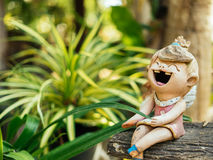 Smile baked clay. Doll funny and laughing  happiness for decorate the garden Royalty Free Stock Image