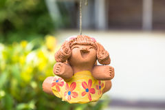 Smile baked clay dolls in the garden Stock Image