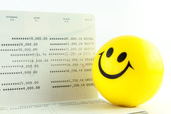 Smile ball and account passbook Royalty Free Stock Photos