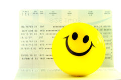 Smile ball on account passbook Royalty Free Stock Images