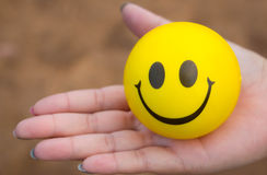 Smile. Ball on the women hand show funny and happy feeling Royalty Free Stock Image