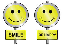 Smile and be happy. Graphic and text signs mounted on post Royalty Free Stock Images
