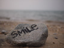 Smile by the Beach. Inspriational message `Smile` at the beach royalty free stock image
