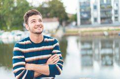Smile beautiful cheerful man in front of river thinking positiv royalty free stock image