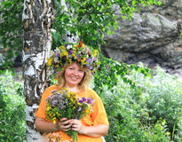 Smile of the beautiful woman in a flower wreath Stock Images