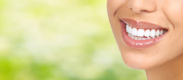 Smile. Beautiful young woman smile close-up. Dental health care Royalty Free Stock Photos