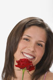 A smile behind a rose Stock Image