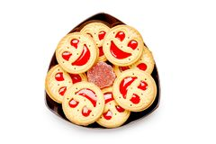 Smile biscuits with red jelly. Isolated on a white background. Royalty Free Stock Photo