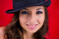 Smile, black hat and red. Smile female wear black hat on red background Royalty Free Stock Photo