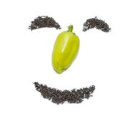 Smile of black tea and green pepper. On white royalty free stock images