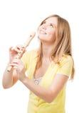 Smile blond girl play horn Stock Image