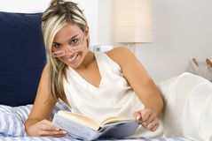 The smile and the book Stock Images