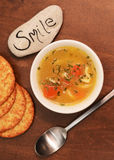 Smile with bowl of soup Stock Images