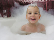 Smile boy in bath Royalty Free Stock Images