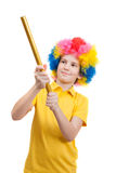 Smile boy in clown wig with party poppers Stock Photo