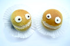 Two Smile bread. Two funny smile bread in the isolated background Stock Photos