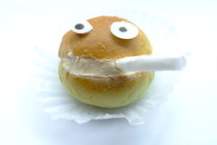 Smile bread smoking. A funny smile bread smoking in the isolated background Royalty Free Stock Photography
