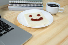 Smile on bread, made of strawberry jam. Closeup smile on bread, made of strawberry jam Royalty Free Stock Image