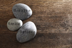 Smile breathe and believe. Stone with text smile,breathe and believe Royalty Free Stock Photo