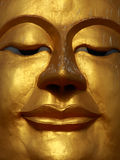 Smile Buddha's face. Close up shot of the smile Buddha's face Stock Photography
