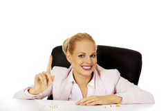 Smile buisness woman with several of cigarettes on the desk Royalty Free Stock Images