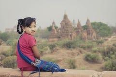The smile of Burma of Asian. The Myanmar girl smiles on pagoda in Bagan Burma stock image