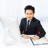 Smile business man working with desktop computer Stock Photo