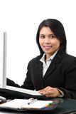 Smile of business woman. A friendly smile of a business woman in her office Royalty Free Stock Photos