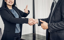 Smile Business woman and  business man shaking hand and thumb up Royalty Free Stock Photo