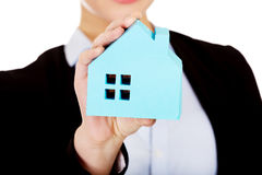 Smile business woman holding a paper house.  Stock Photography