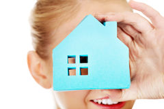 Smile business woman holding a paper house.  Stock Image