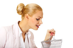 Smile business woman holding small shopping basket Royalty Free Stock Photography