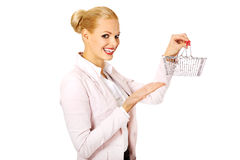 Smile business woman holding small shopping basket Stock Photo