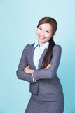 Smile business woman. Isolated on blue background, asian female Royalty Free Stock Photo
