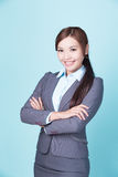 Smile business woman. Isolated on blue background, asian female Royalty Free Stock Image