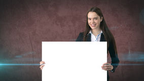Smile Business woman portrait with blank white board on brown isolated. Female model with long hair. Royalty Free Stock Photography