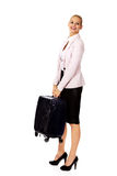 Smile business woman raising her suitcase Stock Photography