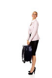 Smile business woman raising her suitcase Royalty Free Stock Photos