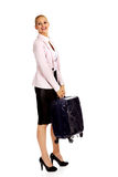 Smile business woman raising her suitcase Royalty Free Stock Image
