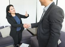Smile Business woman and  business man shaking hand and thumb up Stock Photos