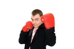 Smile businessman in boxing glove stock photo