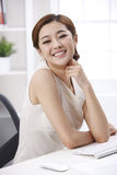 Smile businesswoman. A smile businesswoman,she dress white clothing stock images