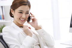 Smile businesswoman calling by mobile telephone Royalty Free Stock Photo