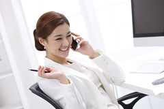 Smile businesswoman calling by mobile telephone Stock Image