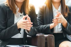Smile businesswoman clapping hands while sitting concept royalty free stock photography