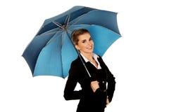 Smile businesswoman holding an umbrella Royalty Free Stock Photos