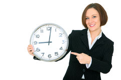 Smile Businesswoman Point At Clock Show 9. Happy businesswoman holding and pointing at clock. isolated on white royalty free stock image